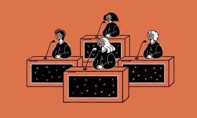 Four people sitting at tables speaking into microphones. An illustrated depiction of a congressional meeting.
