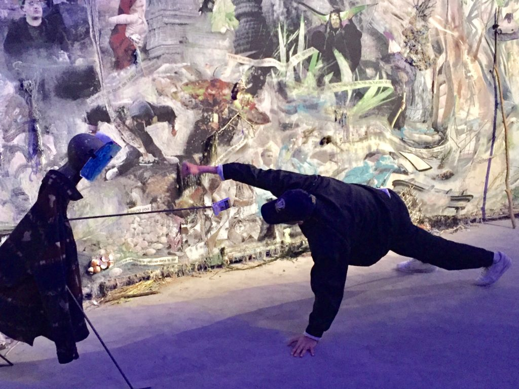 A performer interacts with Laure Prouvost's French pavilion installation. Photo by Naomi Rea.