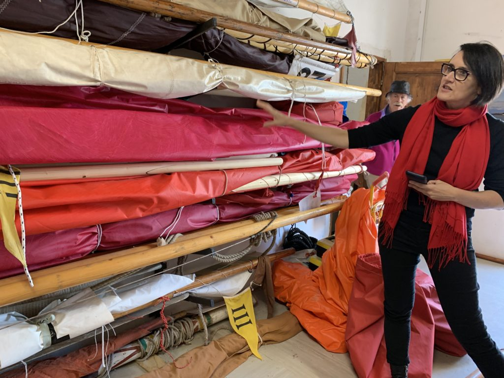 Melissa McGill with some of the sails for <em>Red Regatta</em> at the Associazione Velaal Terzo Venezia. Photo by Juliet Vincente.