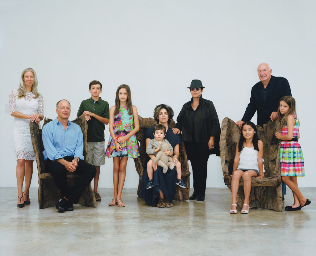 The Rubell family by Rineke Dijkstra. From left: Michelle, Jason, Samuel, Ella, Jennifer, Max Wyss (on lap), Mera, Stevie Kim-Rubell, Don, and Olivia.