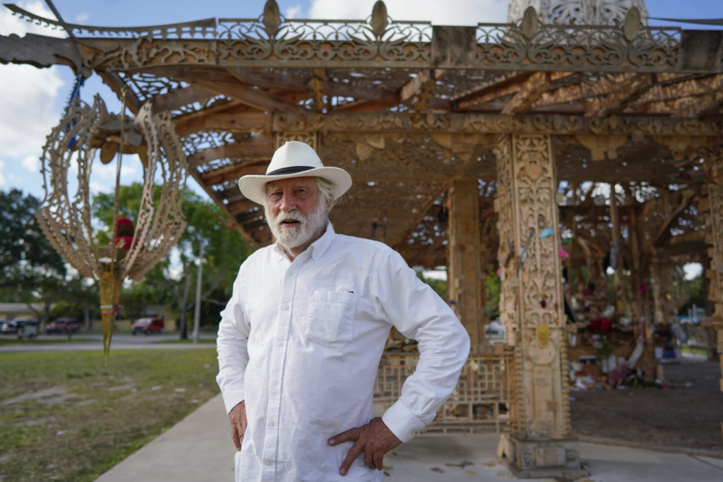David Best with his sculpture <em>Temple of Time</em> (2019). The artwork, which honors the 17 victims of the 2018 Parkland, Florida, shooting, was set on fire May 19, 2019.  Photo by Nicole Craine, courtesy of Bloomberg Philanthropies.