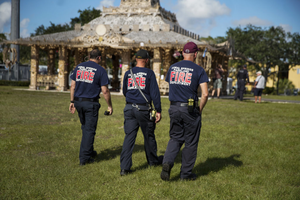Firefighters were on hand as David Best's <em>Temple of Time</em> (2019), which honors the 17 victims of the 2018 Parkland, Florida, shooting, was set on fire May 19, 2019.  Photo by Nicole Craine, courtesy of Bloomberg Philanthropies.