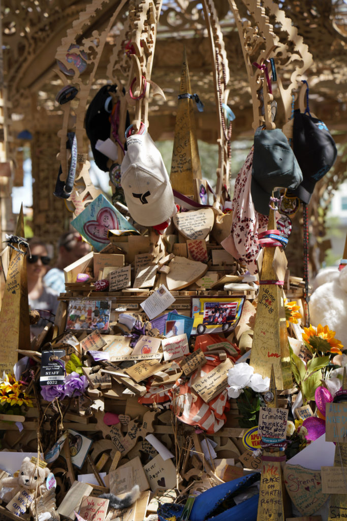 Tributes left on David Best's memorial sculpture Temple of Time (2019). The artwork, which honors the 17 victims of the 2018 Parkland, Florida, shooting, was set on fire May 19, 2019. Photo by Nicole Craine, courtesy of Bloomberg Philanthropies.