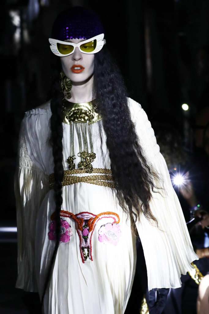 A white dress featured an embroidered uterus.(Photo by Vittorio Zunino Celotto/Getty Images for Gucci)