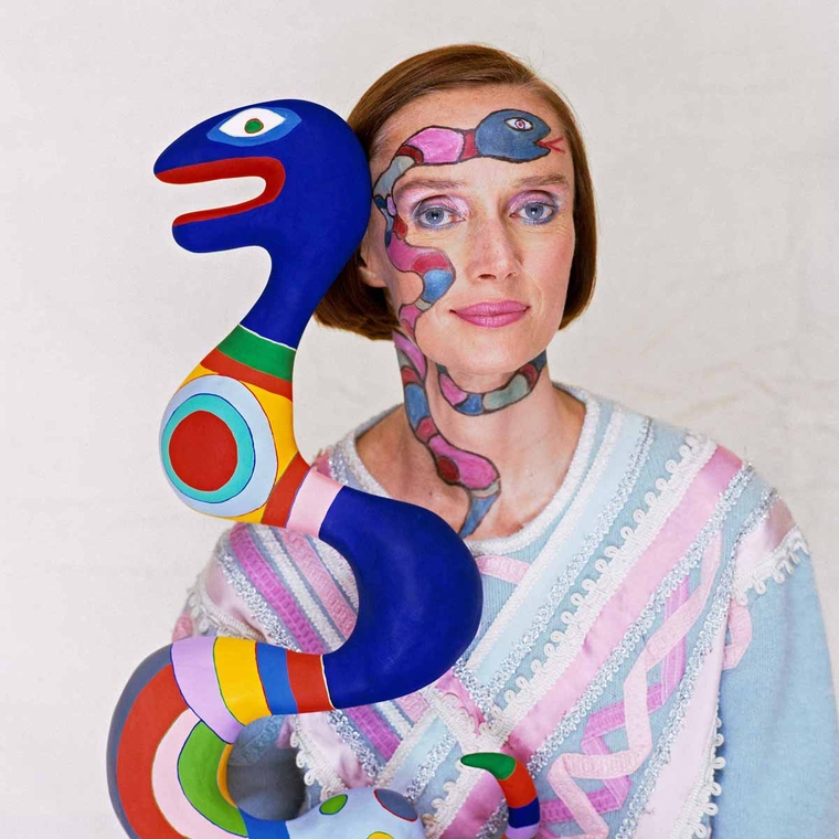 The French sculptor, painter and film-maker, Niki de Saint Phalle (1930 - 2002), photographed with one of her sculptures. Photo: Courtesy of the Norman Parkinson gallery.
