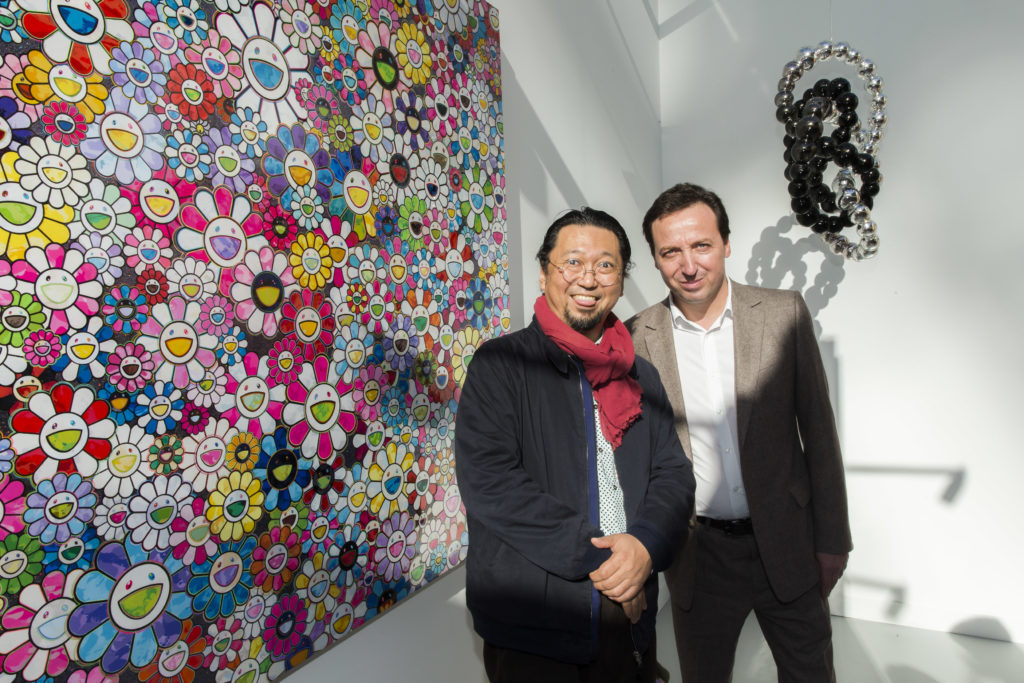 Artist Takashi Murakami and galerist Emmanuel Perrotin attend the opening of the 40th edition of the FIAC International Contemporary Art Fair.(Photo by Bertrand Rindoff Petroff/Getty Images)