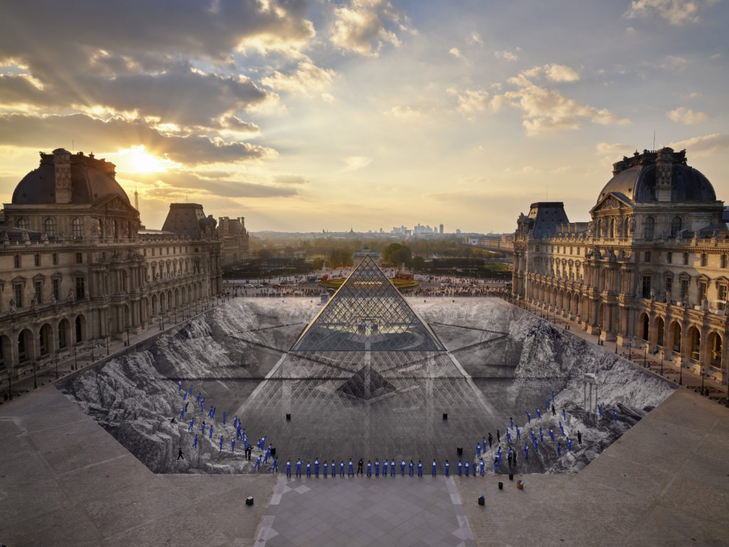 JR's installation at the Louvre in 2019 on the occasion of the pyramid's 30th anniversary. Photo courtesy of JR-art.net / Perrotin Gallery.