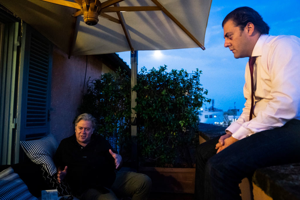 Benjamin Harnwell, right, listens as former White House Chief Strategist Steve Bannon, speaks with a reporter on his terrace at Hotel de Russie on Friday, Sept 21, 2018 in Rome, Italy. Photo: Jabin Botsford/The Washington Post via Getty Images.
