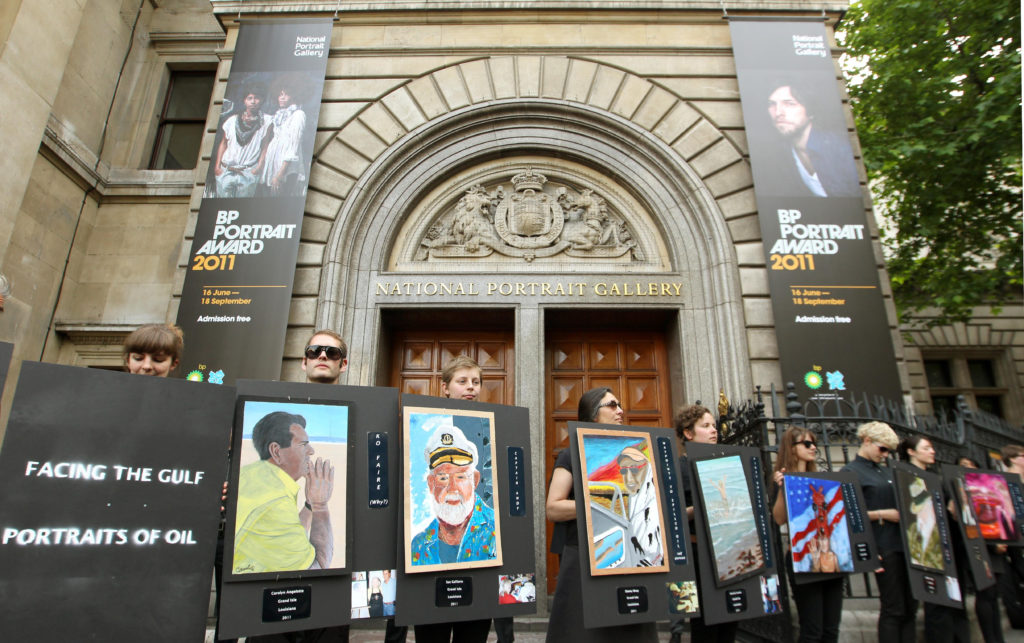 Climate activists protest outside the official opening of the BP Portrait Award 2011, at the National Portrait Gallery, in central London. Photo by Dominic Lipinski/PA Images/Getty Images.