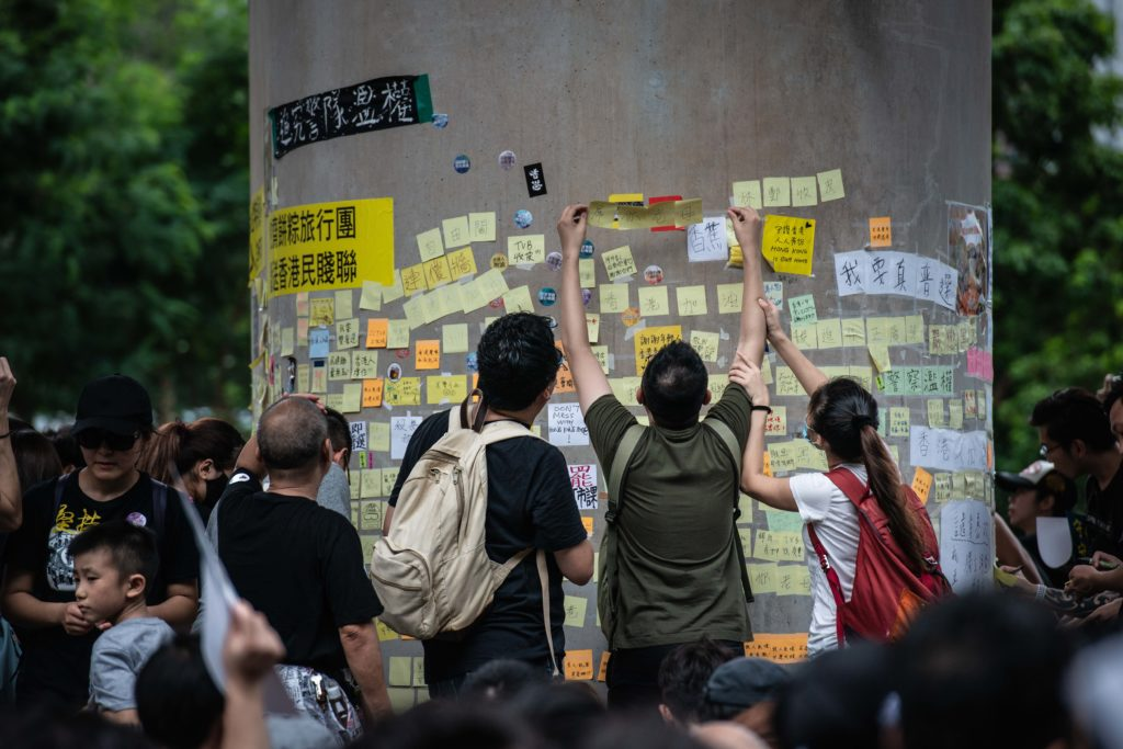 "Demonstrators leave messages on sticky notes on a ""Lennon wall"" during the protests. (Photo by Ivan Abreu/SOPA Images/LightRocket via Getty Images)"