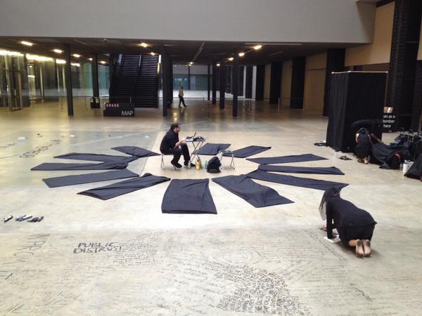 """Protesters participating in the 25-hour """"textual intervention"""" against BP at Tate Modern this weekendPhoto via: Twitter @liberatetate"""