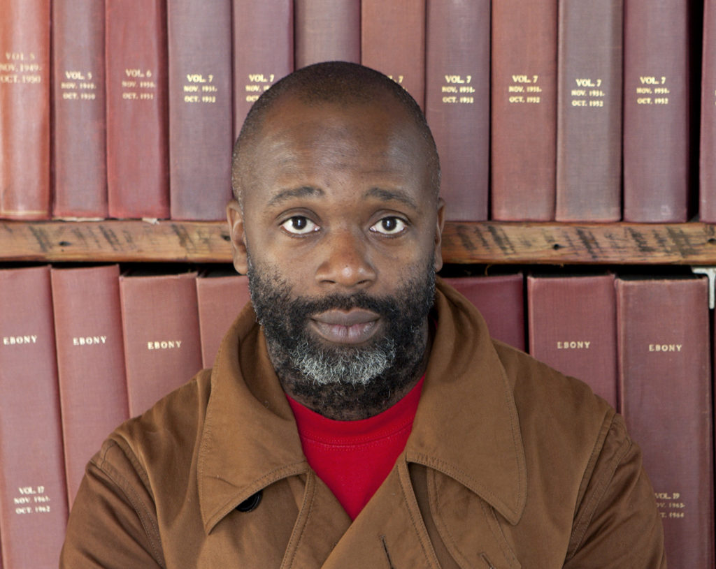 Theaster Gates with part of the Johnson Publishing Archive. Photo by Sarah Pooley, courtesy of the artist.