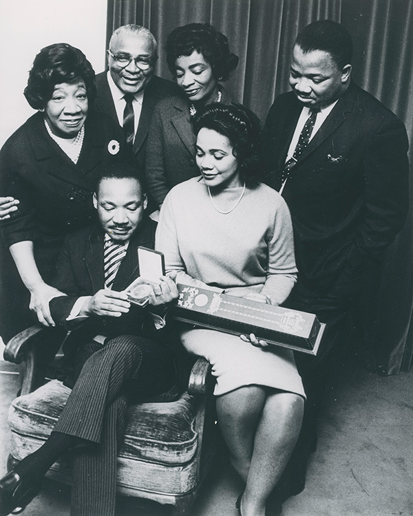Moneta Sleet Jr., Martin Luther King Jr., surrounded by his family, holding the Nobel Peace Prize medal 1964. Photo courtesy Johnson Publishing Company