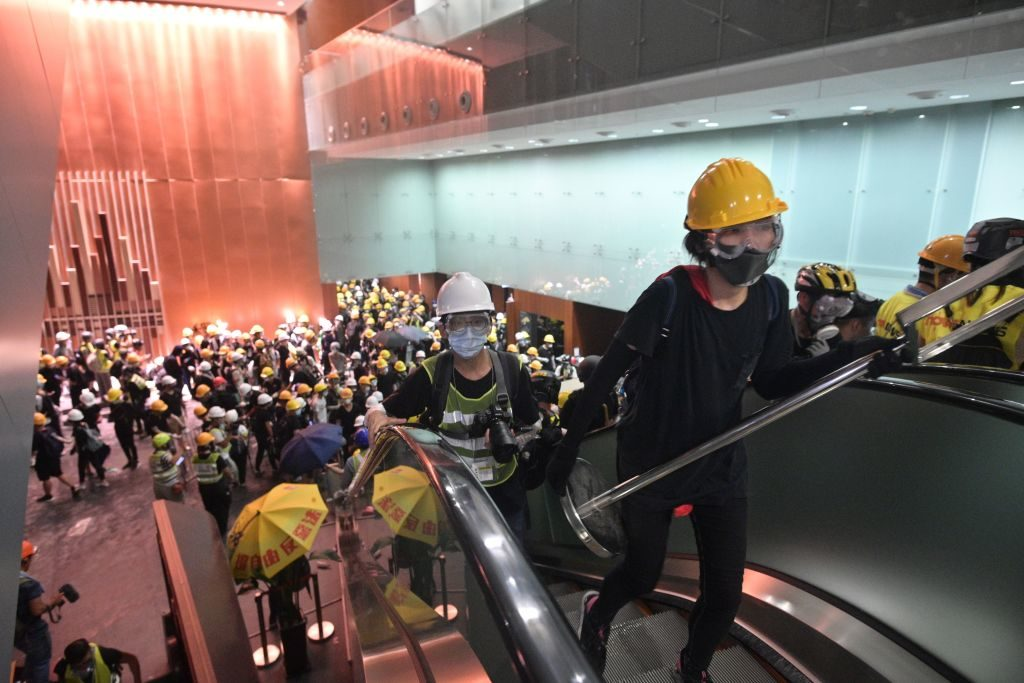 Protesters break into the government headquarters in Hong Kong on July 1, 2019, on the 22nd anniversary of the city
