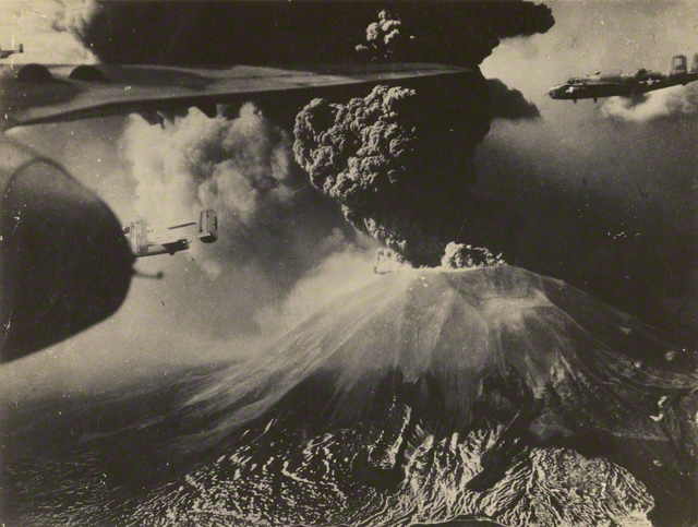 American B-25 Mitchell Bombers fly past Mount Vesuvius during its eruption in March 1944. Photo courtesy of the Archive of Raymond D. Yusi, Army Corps of Engineers.