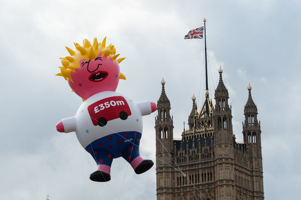 Boris Blimp balloon depicting Tory leadership hopeful Boris Johnson flies next to the Houses of Parliament ahead of anti-Brexit Yes to Europe, no to Boris demonstration on 20 July, 2019 in London, England. Photo by WIktor Szymanowicz/NurPhoto via Getty Images.