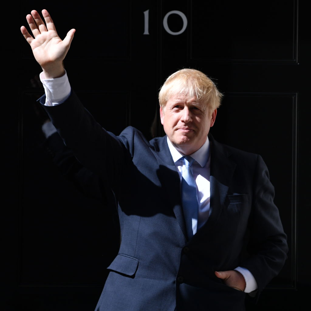 Boris Johnson waves from the door of Number 10, Downing Street. Photo by Jeff J Mitchell/Getty Images.