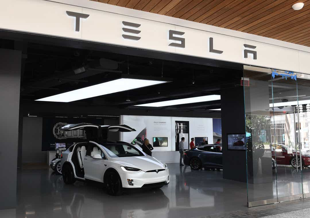 Tesla's stock surges as company breaks delivery and production records
