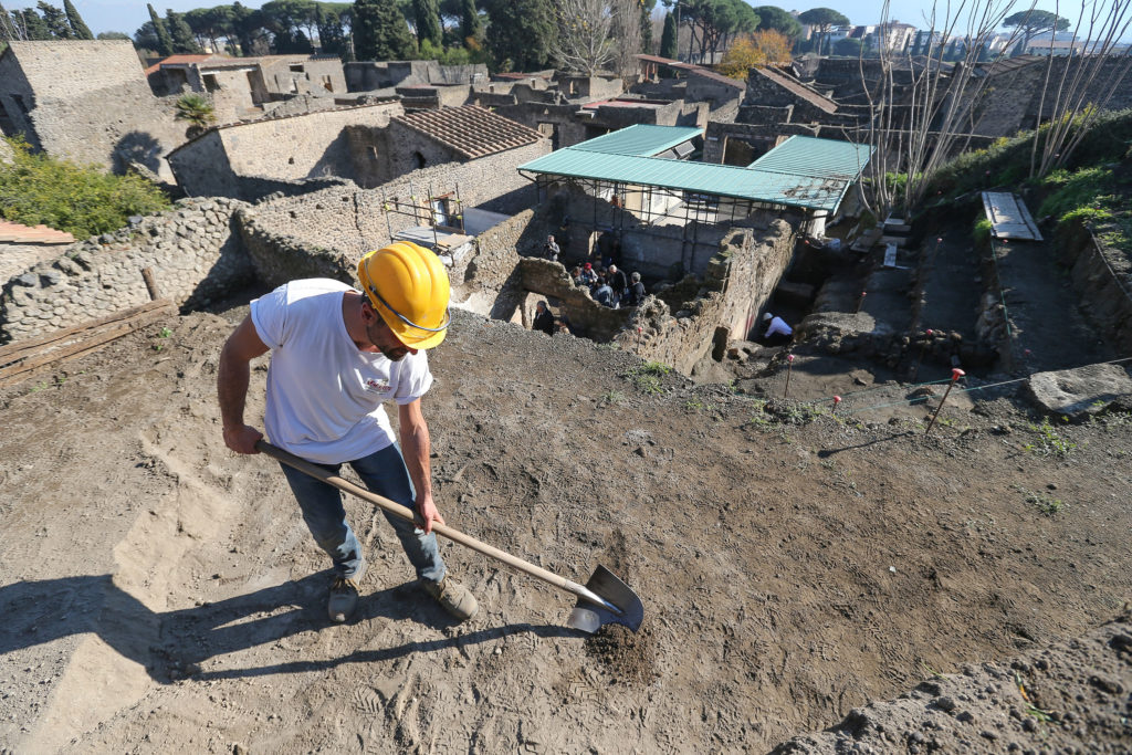 Restorer at work in the Schola Armaturarum, the first excavation of Pompeii in an area that has never been investigated, after more than 20 years, in 2012. Photo by Marco Cantile/LightRocket/Getty Images.