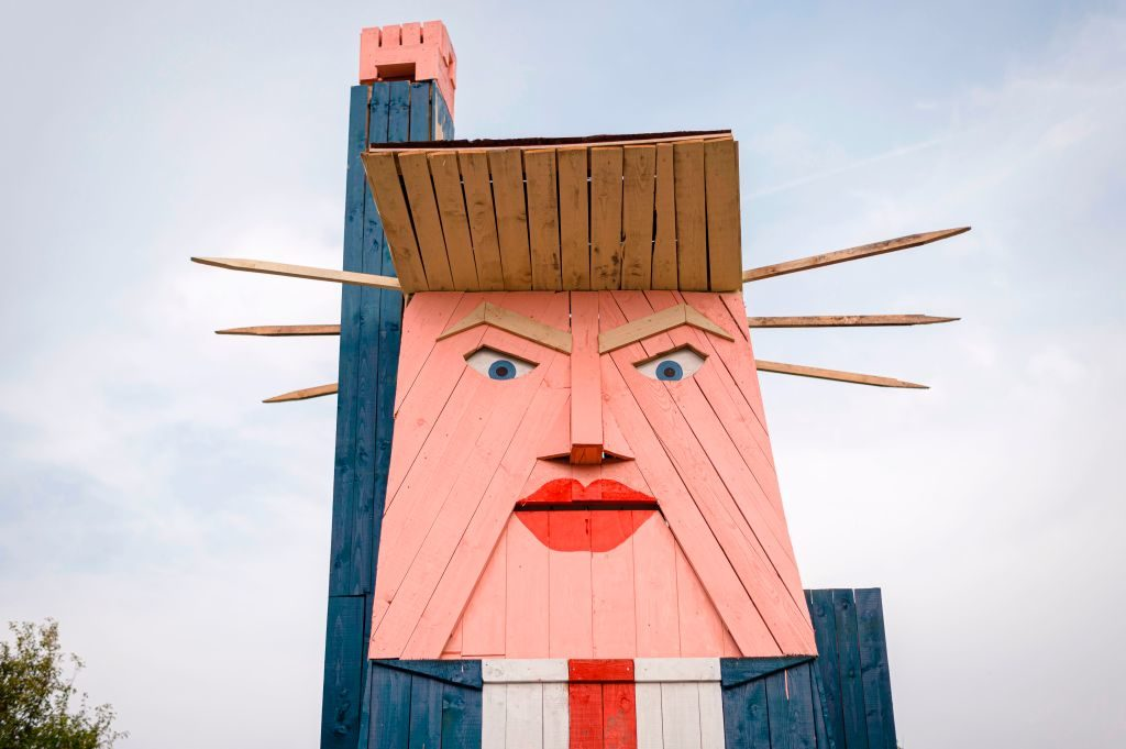 A wooden structure made to resemble US President Donald Trump in the village of Sela pri Kamniku, Slovenia. Photo credit should read JURE MAKOVEC/AFP/Getty Images.