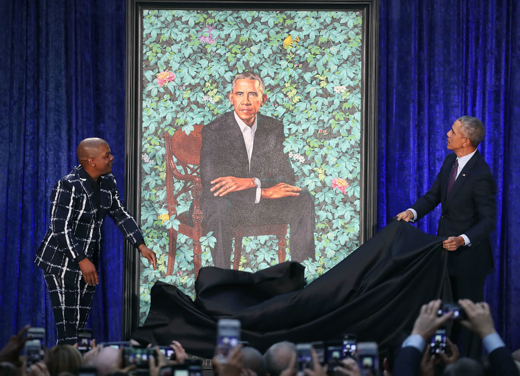 Former U.S. President Barack Obama (R) and artist Kehinde Wiley unveil his portrait during a ceremony at the Smithsonian's National Portrait Gallery, on February 12, 2018 in Washington, DC. Photo by Mark Wilson/Getty Images.