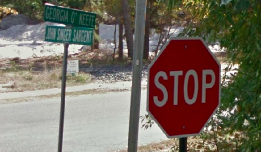 "Street sign for ""Georgia O'Keefe Way."" Screenshot from Google Street View."