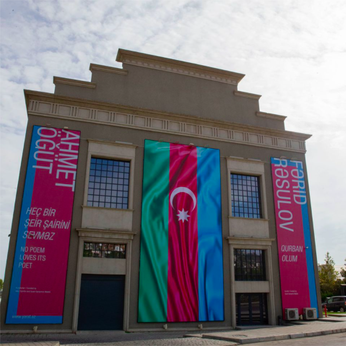 The facade of the Yarat Contemporary Art Space in Baku, Azerbaijan, with a banner promoting Ahmet Ögüt