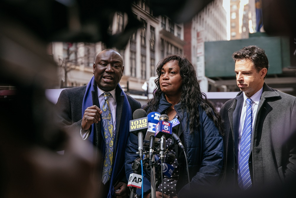 Attorney Benjamin Crump, left, speaks during a press conference announcing the lawsuit against Harvard University. Photo by Kevin Hagen/Getty Images.