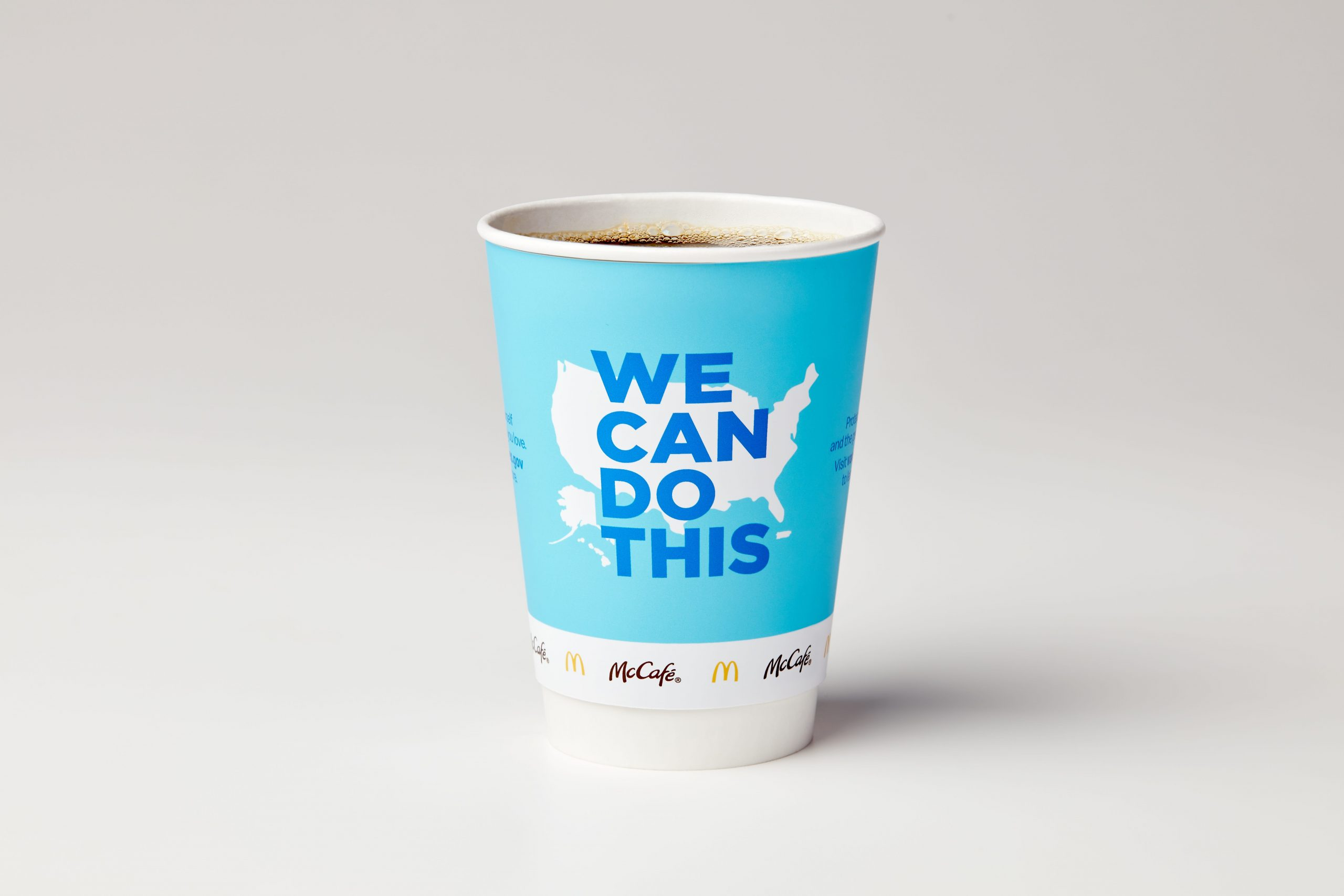 McDonald's is bringing this COVID-19 vaccine awareness message to its coffee cups, Times Square billboard